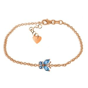 14K. SOLID GOLD BUTTERFLY BRACELET WITH BLUE TOPAZ